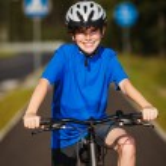 Healthy lifestyle - teenage boy biking — Stock Photo #27100429