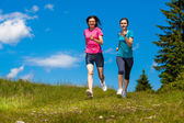 Women running — Stock Photo