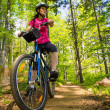 Healthy lifestyle - woman cycling — Stock Photo