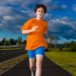 Boy running, jumping outdoor — Stock Photo