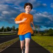 Stock Photo: Boy running, jumping outdoor