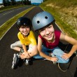 Stock Photo: Active young people - rollerblading, skateboarding
