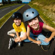 Active young people - rollerblading, skateboarding — Stock Photo