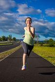 Teenage girl running, jumping outdoor — Fotografia Stock
