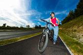 Healthy lifestyle - teenage girl biking — Stock Photo