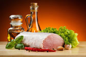 Raw pork on cutting board and vegetables — Stock Photo