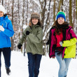 Foto Stock: Active family - mother and kids running outdoor in winter park