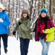 Active family - mother and kids running outdoor in winter park — Foto Stock