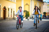 Urban biking - teens riding bikes in city park — Stock Photo