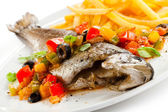 Fish dish - roast trout and vegetables on white background — Stock Photo