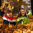 Kids playing in autumn park — Stock Photo #31701767
