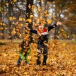 Kids playing in autumn park — Stock Photo #31702303