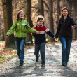 Active family - mother and kids walking, running outdoor — Stock Photo #31703425