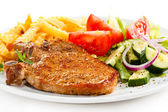 Grilled steak, French fries and vegetables — Stock Photo