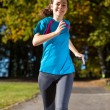 Girl running in park — Stock Photo