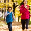 Girl and boy running, jumping in park — Foto de Stock