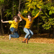 Girl and boy running, jumping in park — Foto Stock