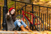 Urban biking - girl and bike in city park — Stock Photo
