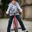 Urban biking - teenage boy and bike in city — Stock Photo #32570353