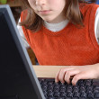 Young girl is learning computer literacy — Stock Photo