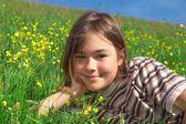 Girl lying on green meadow — Stock Photo
