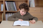 Young boy is reading a book — Stock Photo