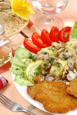 Cutlet with vegetables ,potatoes and champignons — Stock Photo