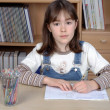 Girl doing homework — 图库照片