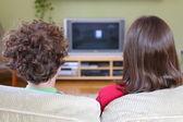 Kids watching tv — Stock Photo