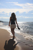 Teenage girl walking on beach — Stock Photo