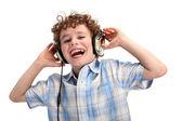 Boy listening to music — Zdjęcie stockowe
