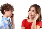 Kids using mobile phone — Stockfoto