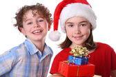 Boy and girl in Santa's Hat — Stok fotoğraf