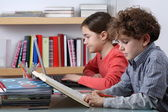 Girl and boy learning — Stock Photo