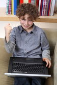 Young boy with his laptop — Stok fotoğraf