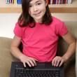 Young girl with her laptop — Stock Photo