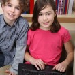 Young kids with laptop — Stock Photo