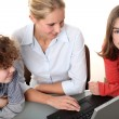 Woman with kids at the laptop — Stock Photo #32700921