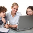 Woman with kids at the laptop — Stock Photo