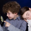 Young boy and girl with alarm clock — Stock Photo #32709019