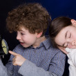Young boy and girl with alarm clock — Stock Photo