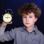 Boy holding alarm clock — Stock Photo