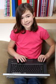 Young girl with her laptop — Foto de Stock
