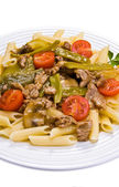 Pasta and roast meat with vegetables — Stock Photo