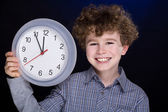 Young boy with clock — Stock Photo