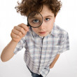 Boy looking through magnifying glass — Stock Photo #32710427