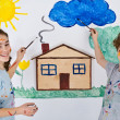 Children painting on wall — Stock Photo #32710951