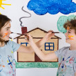 Children painting on wall — Stock Photo