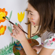 Girl painting on wall — Stock Photo