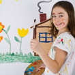 Girl painting on wall — Stockfoto